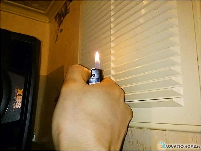 Тестирование работы вытяжки при помощи зажигалки