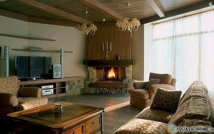 Фото углового камина в интерьере гостиной