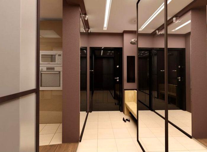 Длинную и узкую прихожую можно визуально расширить с помощью света и зеркал